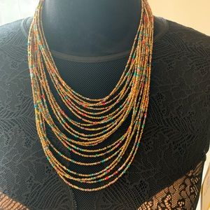 Jewelry - Gold toned multi strand seed beads necklace